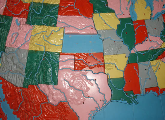 Detail of map with Kansas puzzle piece removed. Relief Map of the United States Detail of cartouche Relief Map of the United States Detail of Kansas puzzle piece.