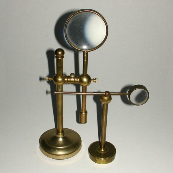 Decorative arrangement of magnifiers on brass stands