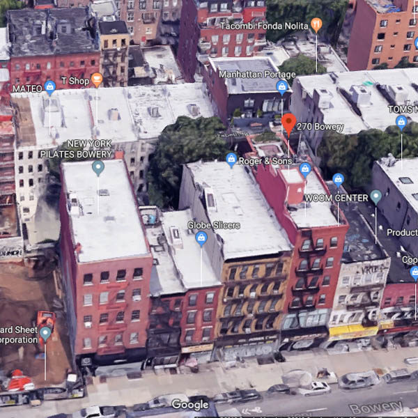 The same block of the Bowery today (Google satellite view).