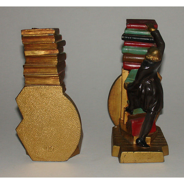 Bookends Pair Man with Falling Stack of Books B