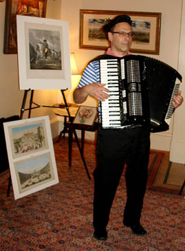 Accordion player with view of Paris and print of Napoleon after Vernet.