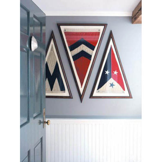 As featured in Connecticut Cottages & Gardens, framed burgees (nautical flags) from the George Glazer Gallery in interior designer Jane Cappelini's dockside home.