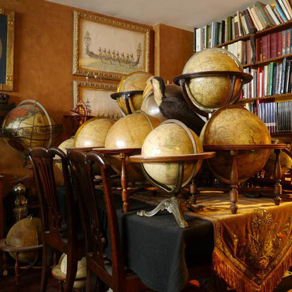 Numerous globes from George's extensive collection