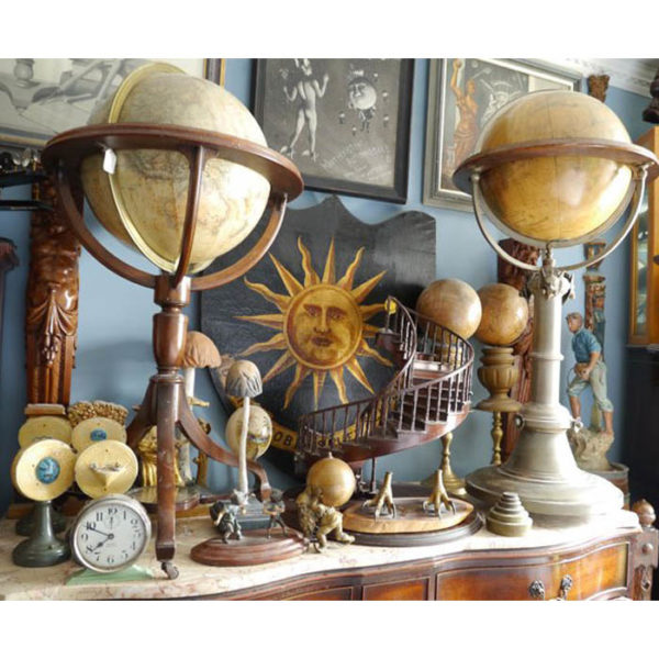 Painted plaque with sun motif, miniature staircase and miniature globes