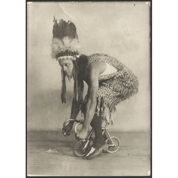 [Joe Ironhand on Tiny Bicycle]