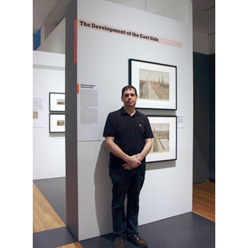 George stands in front of two views lent by our gallery