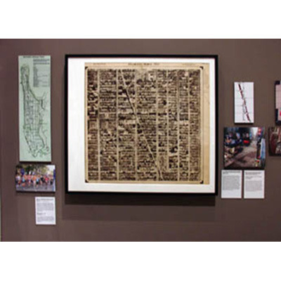At the center of this display, one photographic map, from our gallery's large collection of Hamilton Aerial Maps of Manhattan
