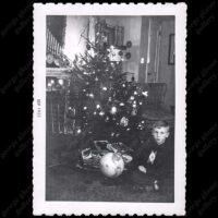 Boy with Globe Christmas Gift, c. 1954