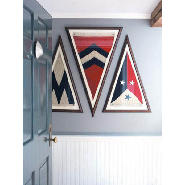 In the entry to Capellini's waterfront vacation home, framed vintage burgees are from the George Glazer Gallery.